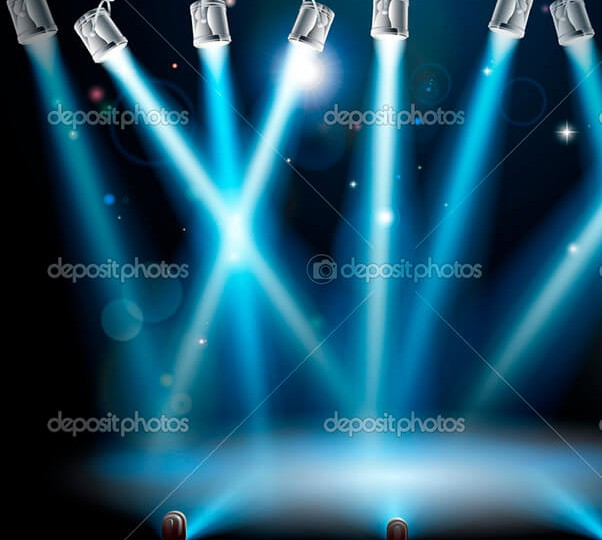 A blue spotlight background concept with lots of lights like spotlights in a light show or during a dramatic theatre stage performance