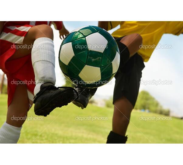depositphotos_21947639-Football-player-tackling-soccer-ball