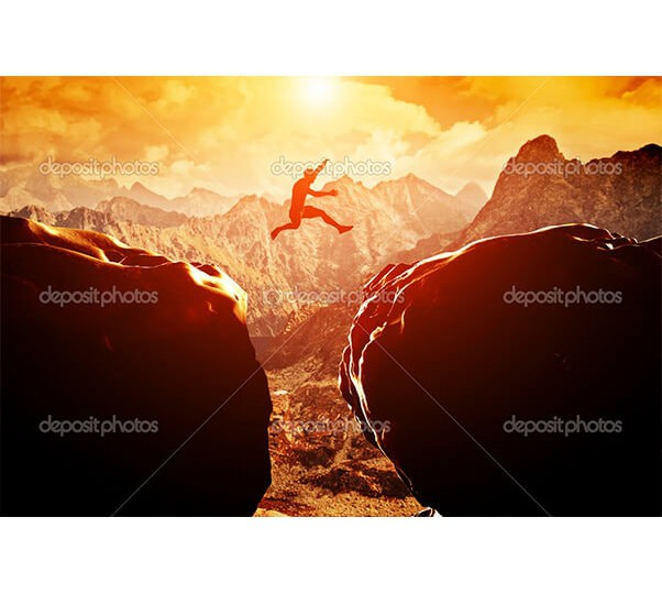 depositphotos_48612283-Man-jumping-over-precipice