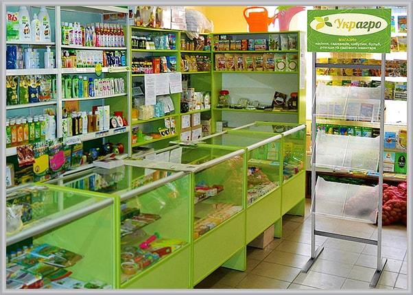 Информационная стойка с карманами под полиграфию для магазина семян